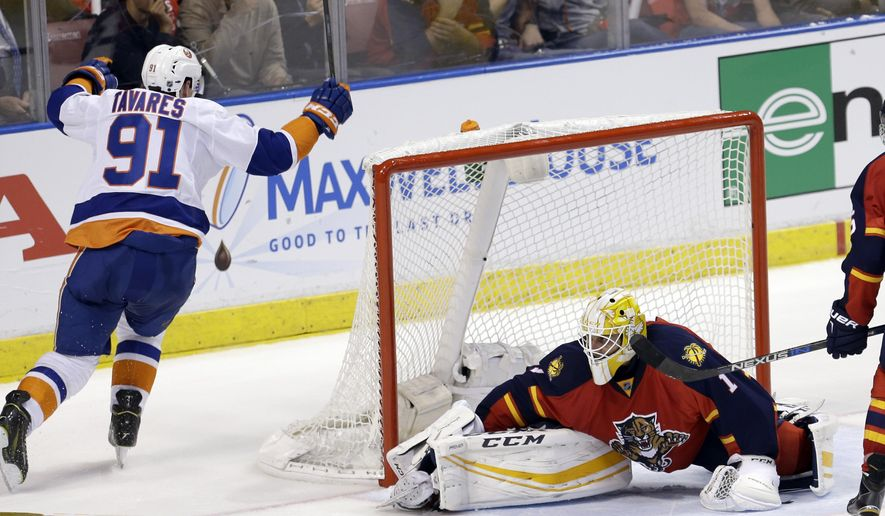 New York Islanders center John Tavares (91) celebrates after scoring a goal against Florida Panthers goalie Roberto Luongo (1) during the second period of Game 1 in a first-round NHL hockey Stanley Cup playoff series, Thursday, April 14, 2016, in Sunrise, Fla. (AP Photo/Alan Diaz)