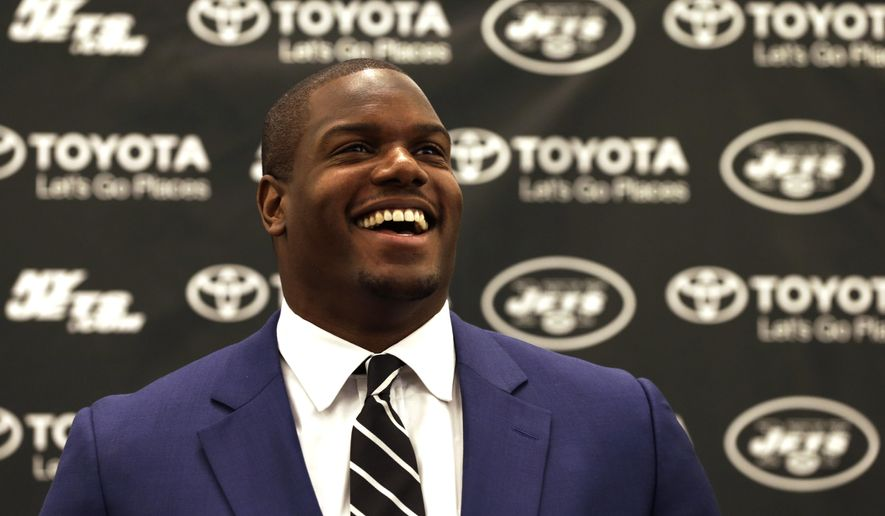 New York Jets' D'Brickashaw Ferguson laughs while speaking to the media about retirement during a press conference on Thursday, April 14, 2016 at the team's practice facility in Florham Park, N.J. . (AP Photo/Adam Hunger)