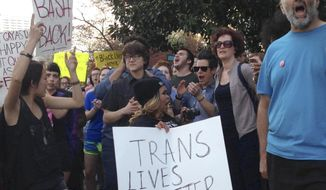 FILE- In this March 24, 2016, file photo, people protest outside the North Carolina Executive Mansion in Raleigh, N.C. A South Carolina proposal to forbid transgender people from using restrooms that correspond to their gender identity is part of a backlash by lawmakers across the historically conservative South. North Carolina passed a law that bans cities and counties from passing anti-discrimination ordinances. (AP Photo/Emery P. Dalesio, File )