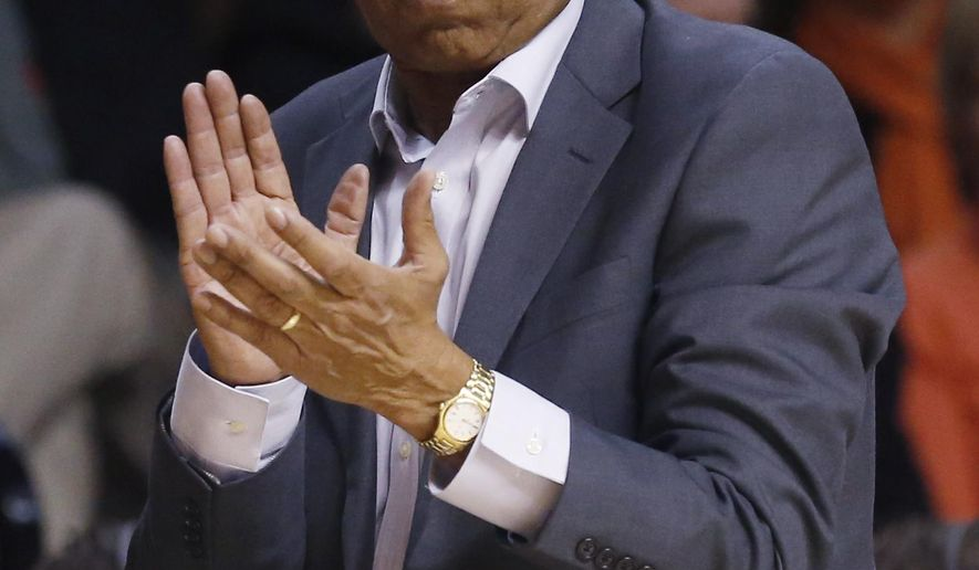 FILE - In this Jan. 22, 2015, file photo, Texas Tech head coach Tubby Smith gestures during an NCAA college basketball game against Oklahoma State in Stillwater, Okla. Memphis has hired Tubby Smith as its new men's basketball coach, choosing to go with a veteran to get the Tigers back to the NCAA Tournament. The university announced the hire Thursday, April 14, 2016, on its athletic department's website. (AP Photo/Sue Ogrocki, File)