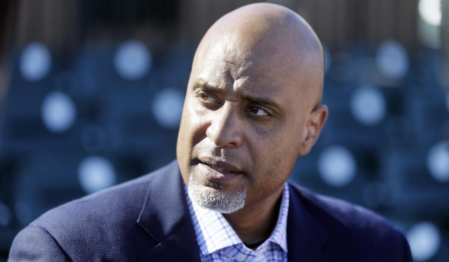 FILE - In this March 17, 2015, file photo, Tony Clark, head of the baseball players' union, talks to the media before a spring training baseball game between the Detroit Tigers and the Washington Nationals in Lakeland, Fla. THe union is frustrated many of its retired members–especially minorities–can't find jobs working for teams and has asked MLB to help launch a career preparation project. Clark, a former All-Star first baseman, outlined the plan during an interview with The Associated Press on Thursday, April 14, 2016. (AP Photo/Carlos Osorio, File)