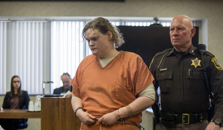 Elizabeth Long is led out of the courtroom after sentencing Thursday, April 14, 2016, at the St. Clair County Courthouse in Port Huron, Mich. Long was sentenced to 22 to 50 years in prison for second-degree murder and second-degree child abuse in the death of her 16-month-old son, Lukas. (Jeffrey M. Smith/Times Herald via AP)