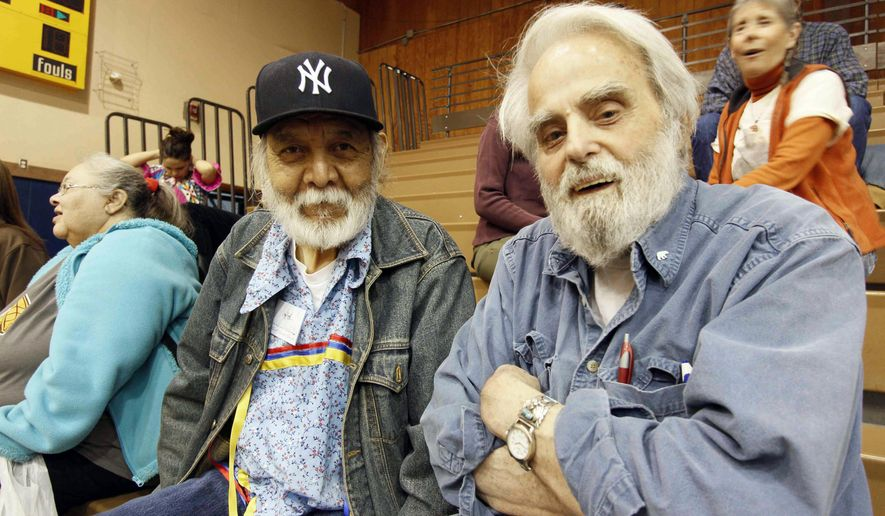 """This 2013 photo provided by the Great Bear Foundation shows Chuck Jonkel, right, and Salish poet Vic Charlo in Missoula, Mont. Pioneering bear researcher and advocate Charles """"Chuck"""" Jonkel died Tuesday, Aprill 12, 2016, of natural causes at a Missoula, Mont., nursing home, his son Jamie Jonkel said. He was 85. Jonkel led the Border Grizzly Project shortly after the bears were placed under the protection of the Endangered Species Act in 1975. (Frank Tyro/Great Bear Foundation via AP)"""