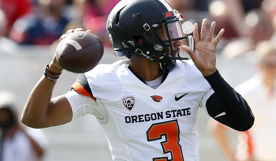 FILe - In this Oct. 10, 2015 file photo, Oregon State quarterback Marcus McMaryion throws down field against Arizona during the first half of an NCAA college football game in Tucson, Ariz. McMaryion is much more at ease when it comes to the quarterback competition at Oregon State, even if it feels as uncertain as it was last season. The sophomore QB has a year of experience when it comes to vying for the starting job and he knows the kind of twists the depth chart can take from week to week.(AP Photo/Rick Scuteri, File)
