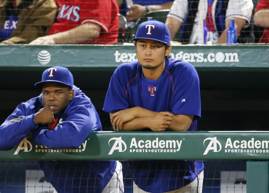 Texas Rangers' Hanser Alberto, left, and Yu Darvish watch during the fifth inning of the team's baseball game against the Baltimore Orioles, Thursday, April 14, 2016, in Arlington, Texas. (AP Photo/Tony Gutierrez)