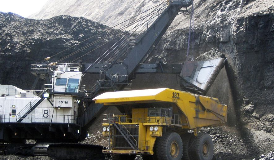 FILE - In this April 30, 2007, file photo, a shovel prepares to dump a load of coal into a 320-ton truck at the Arch Coal Inc.-owned Black Thunder mine in Wright, Wyo. Arch Coal filed for Chapter 11 bankruptcy protection in January 2016. The bankruptcy filing of coal mine operator Peabody Energy Wednesday, April 13, 2016, raises yet more questions about the ability of financially troubled coal companies to cover the potential cost of filling in mines that close. (AP Photo/Matthew Brown, File)