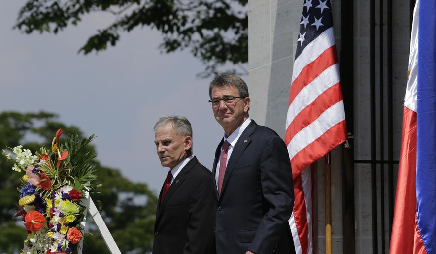 "U.S. Defense Secretary Ash Carter, right, and Hubert Caloud, Manila American Cemetery Deputy Superintendent, walks out of a chapel during his visit at the American Cemetery and Memorial in suburban Taguig, south of Manila, Philippines on Thursday, April 14, 2016. Carter is in the country as U.S. and Philippine forces participate in a joint military exercise called shoulder-to-shoulder or ""Balikatan"". (AP Photo/Aaron Favila)"