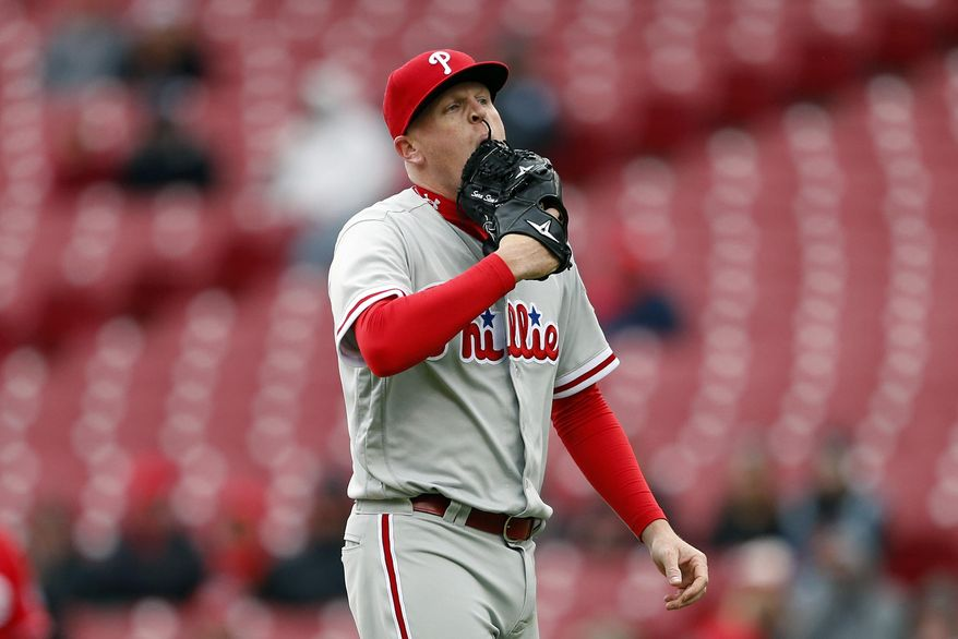 FILE - In this April 7, 2016 file photo, Philadelphia Phillies relief pitcher Daniel Stumpf walks to the dugout after being pulled from the game during the fourth inning of a baseball game against the Cincinnati Reds, in Cincinnati. Philadelphia Phillies pitcher Daniel Stumpf has been suspended for 80 games without pay by Major League Baseball after testing positive for a performance-enhancing substance. The suspension was issued Thursday, April 14, 2016 by Commissioner Rob Manfred's office. (AP Photo/Gary Landers, File)
