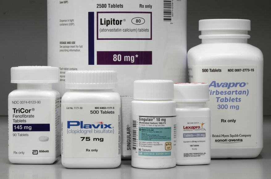 In this June 14, 2011, photo, bottles of prescription drugs: Lipitor, TriCor, Plavix, Singulair, Lexapro and Avapro are displayed at Medco Health Solutions Inc. in Willingboro, N.J. U.S. spending on prescription drugs rose 8.5 percent last year, slightly less than in 2014, driven mainly by growing use of ultra-expensive new drugs and price increases on other medicines. A report from data firm IMS Health estimates patients, insurers, government programs and other payers spent a combined $309.5 billion last year on prescription medicines. (AP Photo/Matt Rourke, File)