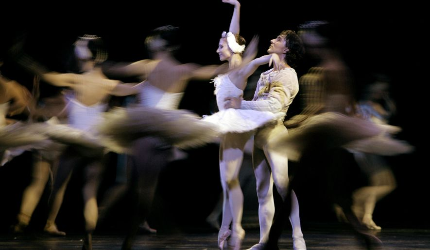 "FILE - In this file photo dated Sunday Sept. 23, 2007, Ballet dancers Julio Bocca, right, and Alina Cojocaru perform Swan Lake in Buenos Aires, Argentina, Sunday Sept. 23, 2007.  Romania Opera house artistic director Johan Kobborg, of Denmark, has resigned, and it is announced Thursday April 14, 2016, that Romania's Prime Minister Dacian Ciolos intends to help find a solution to a bitter dispute raging at the Romanian Opera.  Ciolos decided to step in to the dispute after his meeting with internationally renowned ballerina Alina Cojocaru who says she won't dance Manon this weekend and claims there is an atmosphere of ""fear and intimidation.""  (AP Photo/Natacha Pisarenko, FILE)"
