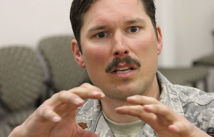 Alaska Air National Guard Maj. Brock Roden discusses the rescue of two skiers stranded on an Alaska ice field earlier in the week at Joint Base Elmendorf-Richardson in Anchorage, Alaska, Thursday, April 14, 2016. Roden and the others were dropped off by a helicopter and had to ski nearly 15 miles on the Harding Ice Field, trying to reach two skiers who had been stranded by four days in blizzard-like conditions. (AP Photo/Mark Thiessen)