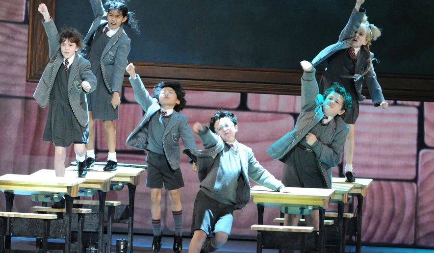 """FILE - In this June 9, 2013 file photo, the cast of """"Matilda The Musical"""" perform at the 67th Annual Tony Awards in New York. The Tony Award-winning English import """"Matilda"""" will stop terrorizing Broadway early next year. Producers of the witty musical adaptation of the beloved novel by Roald Dahl said Thursday, April 14, 2016, the show will close at Shubert Theatre on Jan. 1, having played close to 1,600 performances. (Photo by Evan Agostini/Invision/AP, File)"""