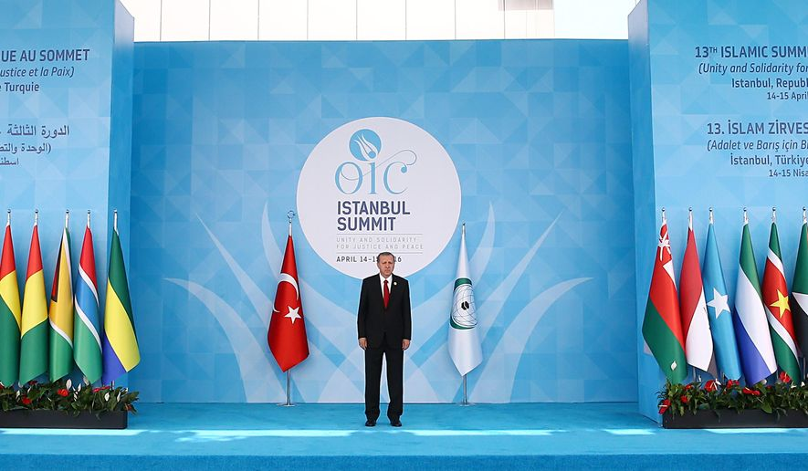 Turkey's President Recep Tayyip Erdogan waits for the arrivals of leaders and representatives of the Islamic countries before the opening of the 13th Organization of Islamic Cooperation, OIC, Summit in Istanbul, Thursday, April 14, 2016. Turkey hosts the two-day 13th OIC Summit with presidents, prime ministers and ministers attending to discuss several issues.(Presidential Press Service/Pool Photo via AP)