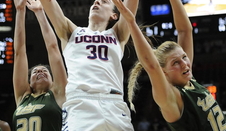 FILE - In this Feb. 29, 2016 file photo, Connecticut's Breanna Stewart goes up for a basket as South Florida's Laura Ferreira, left, and Maria Jespersen defend in the second half of an NCAA college basketball game in Storrs, Conn. Breanna Stewart is a lock to go to Seattle with the first pick. Her UConn teammates Moriah Jefferson and Morgan Tuck could go second and third, marking the first time in league history the top three picks came from the same school. (AP Photo/Jessica Hill)