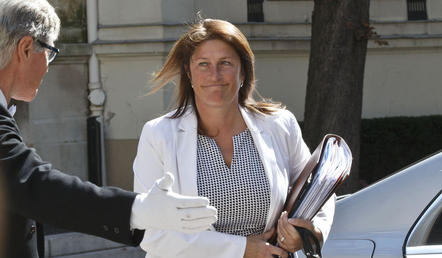 In this Saturday, Aug. 29, 2015, file photo, Belgium's Minister for Mobility Jacqueline Galant, arrives for an emergency meeting in Paris, France. Belgium's transport minister Jacqueline Galant resigned on Friday, April 15, 2016, after a secret European Union report detailing lapses in airport security oversight was leaked in the wake of the March 22 bombings at Brussels Airport and subway. (AP Photo/Michel Euler, File)