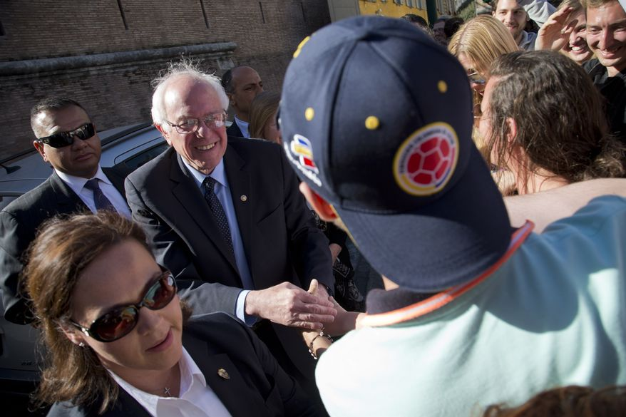 """US presidential candidate Bernie Sanders meets a group of supporters outside the Perugino gate at the Vatican, Friday, April 15, 2016. Sanders spoke at a conference commemorating the 25th anniversary of """"Centesimus Annus,"""" a high-level teaching document by Pope John Paul II on the economy and social justice at the end of the Cold War. (AP Photo/Alessandra Tarantino)"""