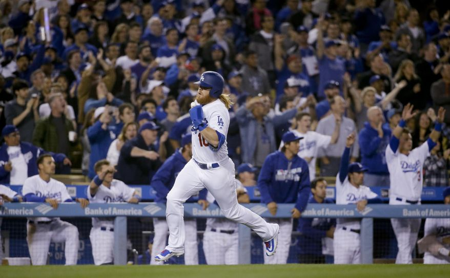 Los Angeles Dodgers' Justin Turner scores on a double by Enrique Hernandez during the seventh inning of a baseball game against the Arizona Diamondbacks in Los Angeles, Thursday, April 14, 2016. (AP Photo/Chris Carlson)