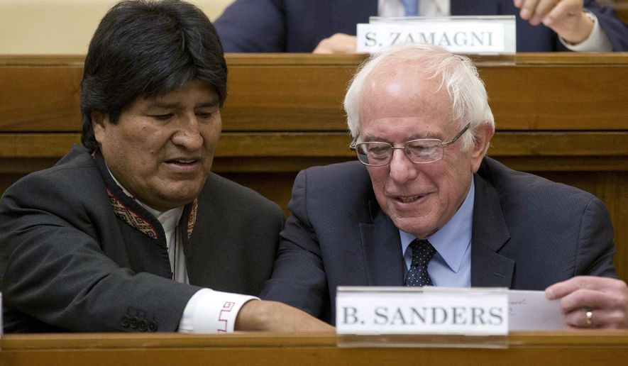 "US Democratic presidential candidate, Sen. Bernie Sanders, I-Vt. right, speaks with Bolivia president Evo Morales during a conference commemorating the 25th anniversary of ""Centesimus Annus,"" a high-level teaching document by Pope John Paul II on the economy and social justice at the end of the Cold War, at the Vatican, Friday, April 15, 2016. (AP Photo/Andrew Medichini)"