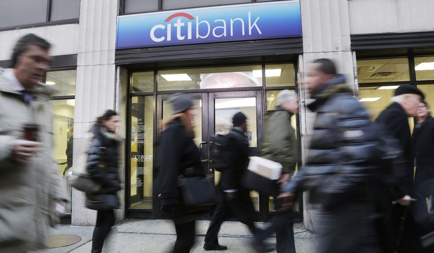FILE - In this Thursday, Jan. 15, 2015, file photo, people walk past a branch office of Citibank, in New York. On Friday, April 15, 2016, Citigroup reports financial results. (AP Photo/Mark Lennihan, File)