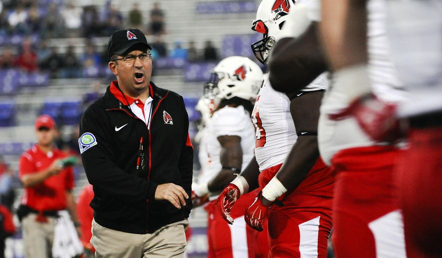 FILE - In this Sept. 26, 2015, file photo, Ball State head coach Pete Lembo talks with players before an NCAA college football game against Northwestern in Evanston, Ill. A year after Dan Enos left a head coaching job at Central Michigan to become the offensive coordinator at Arkansas, Pete Lembo made a similar MAC-to-Power Five move, going from head coach at Ball State to assistant at Maryland.  Is the widening revenue gap in FBS between the Power Five conferences and the Group of Five making it more difficult for some schools to hire and retain quality coaches? (AP Photo/Matt Marton, File)