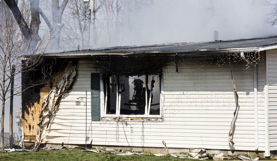 In this Thursday, April 14, 2016 photo firefighters work to extinguish a blaze at a home in Thetford Township, in Flint, Mich. At least two people were reportedly killed in the fire. (Conor Ralph /The Flint Journal-MLive.com via AP) LOCAL TELEVISION OUT; LOCAL INTERNET OUT; MANDATORY CREDIT