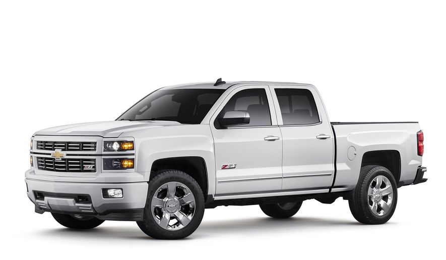 This photo provided by General Motors shows 2015 Chevrolet Silverado 1500 LTZ Z71 with Custom Sport special edition package.  On Friday, April 15, 2016, General Motors is recalling more than a million Chevrolet Silverado and GMC Sierra pickup trucks worldwide because the seat belts may not hold people in a crash. The recall covers certain model 1500 pickups from the 2014 and 2015 model years. GM says a steel cable that connects the belts to the trucks can wear and separate over time. If that happens, the belts could come loose. (General Motors via AP)