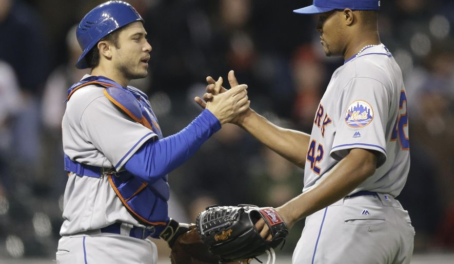 New York Mets relief pitcher Jeurys Familia, right, is congratulated by catcher Travis d'Arnaud after they defeated the Cleveland Indians in an interleague baseball game, Friday, April 15, 2016, in Cleveland. (AP Photo/Tony Dejak)