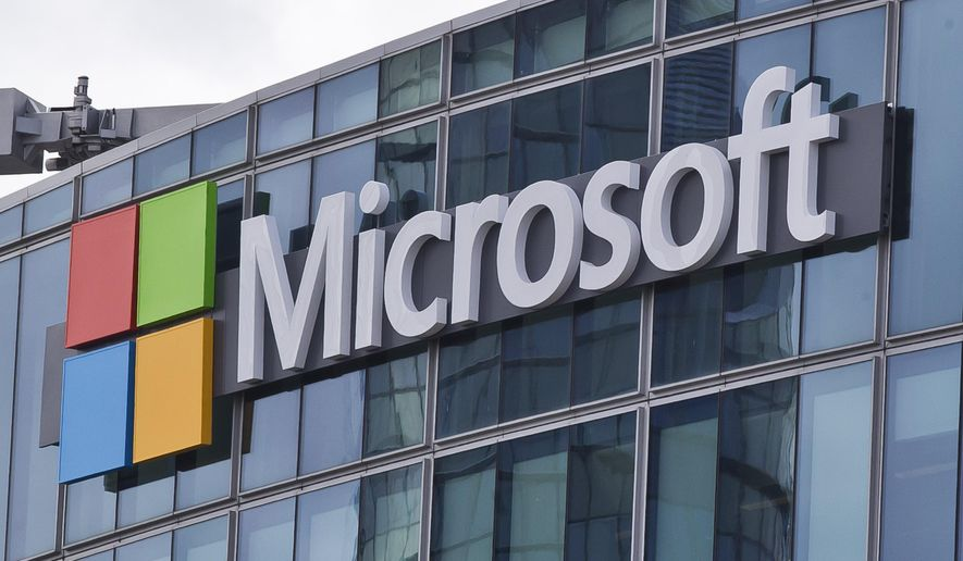 This Tuesday, April 12, 2016, photo shows the Microsoft logo in Issy- les-Moulineaux, outside Paris, France. Microsoft opened a new front in the battle over digital privacy this week, suing the Justice Department on Thursday, April 14, 2016, over its use of court orders requiring the company to turn over customer files stored in its computer centers often without notifying the customer involved. (AP Photo/Michel Euler, File)