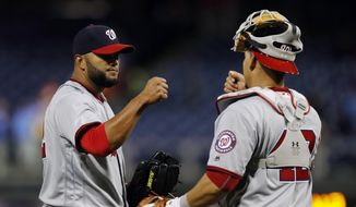 Washington Nationals relief pitcher Yusmeiro Petit, left, celebrates with catcher Wilson Ramos after a baseball game against the Philadelphia Phillies, Friday, April 15, 2016, in Philadelphia. Washington won 9-1. (AP Photo/Matt Slocum) **FILE**
