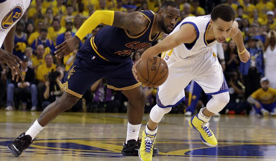 FILe - In this June 7, 2015 file photo, Cleveland Cavaliers forward LeBron James (23) watches as Golden State Warriors guard Stephen Curry dribbles during the second half of Game 2 of basketball's NBA Finals in Oakland, Calif. For months, the Cavaliers' megastar has lived slightly under the radar, if that's even possible for one of the world's most famous and recognizable athletes. While Stephen Curry rained 3-pointers as the new face of the NBA, the Golden State Warriors hunted down history and Kobe Bryant took his final bows, James remained in the background awaiting his turn. (AP Photo/Ben Margot, File)