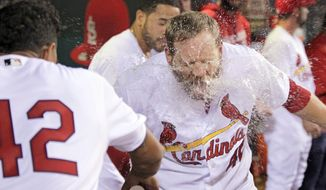 St. Louis Cardinals' Brandon Moss gets a faceful of water from teammate Carlos Martinez after hitting a three-run home run in the seventh inning of a baseball game against the Cincinnati Reds, Friday, April 15, 2016 in St. Louis. (AP Photo/Tom Gannam)