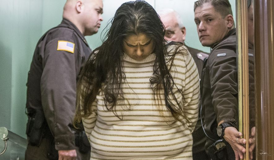FILE - In this Monday, March 30, 2015 file photo, Purvi Patel is taken into custody after being sentenced to 20 years in prison for feticide and neglect of a dependent, at the St. Joseph County Courthouse in South Bend, Ind. Lynn Paltrow, executive director of National Advocates for Pregnant Women, said it marked the first time a woman in the U.S. has been convicted and sentenced for attempting to end her pregnancy. (Robert Franklin/South Bend Tribune via AP)