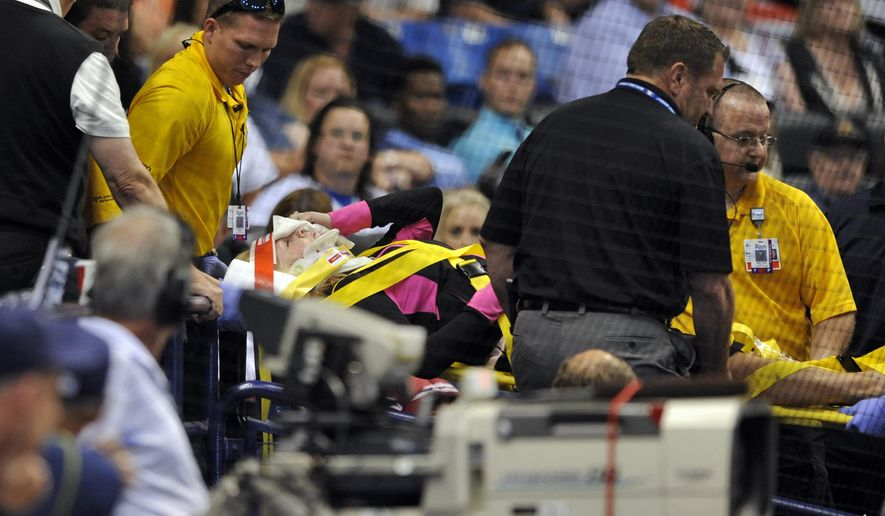 Medical personnel carry a fan from the stands by stretcher after she was hit a foul ball from Tampa Bay Rays designated hitter Steven Souza Jr. during the seventh inning of a baseball game against the Chicago White Sox, Friday, April 15, 2016, in St. Petersburg, Fla. (AP Photo/Steve Nesius)