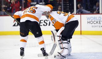 RETRANSMISSION TO CORRECT TO GAME 2 INSTEAD OF GAME 1 - Philadelphia Flyers center Ryan White (25) reacts with goalie Steve Mason (35) after Mason misplayed the puck allowing for a goal by Washington Capitals left wing Jason Chimera during the second period of Game 2 in the first round of the NHL Stanley Cup hockey playoffs, Saturday, April 16, 2016, in Washington. (AP Photo/Alex Brandon)