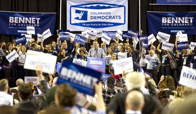 U.S. Sen. Michael Bennet addresses attendees at the 2016 Colorado Democratic Assembly and Convention Saturday, April 16, 2016, at the Budweiser Events Center in Loveland, Colo. (Michael Brian/Loveland Reporter-Herald via AP)
