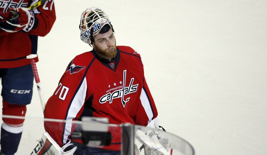 Washington Capitals goalie Braden Holtby (70) skates off the ice after during Game 2 in the first round of the NHL Stanley Cup hockey playoffs against the Philadelphia Flyers, Saturday, April 16, 2016, in Washington. The Capitals won 4-1. (AP Photo/Alex Brandon)