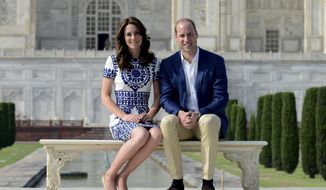 Britain's Prince William, along with his wife, Kate, the Duchess of Cambridge, pose in front of the Taj Mahal in Agra, India, Saturday, April 16, 2016. Agra is the last stop on the royal couple's weeklong visit to India and neighboring Bhutan. (Money Sharma/ Pool photo via AP)