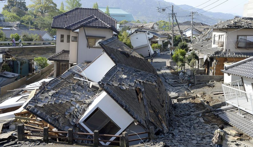 Houses are seen destroyed after an earthquake in Mashiki, Kumamoto prefecture, southern Japan Saturday, April 16, 2016. A powerful earthquake struck southern Japan early Saturday, barely 24 hours after a smaller quake hit the same region. (Ryosuke Uematsu/Kyodo News via AP)