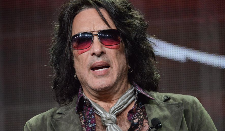 """FILE - In this July 11, 2014 file photo, Paul Stanley speaks onstage during the """"4th and Loud"""" portion of the AMC 2014 Summer TCA in Beverly Hills, Calif. Shoulder surgery has prevented Stanley from performing an intimate show with KISS. Gene Simmons, Ace Frehley and Peter Criss donned their classic stage makeup and costumes to play a four-song set Friday, April 15, 2016, to benefit multiple sclerosis research. (Photo by Richard Shotwell/Invision/AP, File)"""