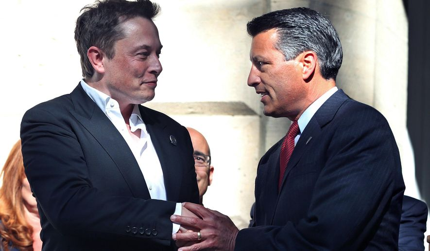 In this Sept. 4, 2014, photo, Tesla Motors CEO Elon Musk, left, and Nevada Gov. Brian Sandoval shake hands following a news conference where Nevada was announced as the new site for a car battery gigafactory, at the Capitol in Carson City, Nev. Several company leaders said electric car company Tesla, which is building a massive battery plant near Reno, was responsible, in part, for triggering new interest in Nevada's potential supply of lithium.  (AP Photo/Cathleen Allison, File)