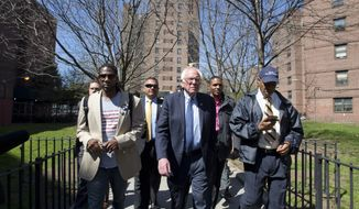 Democratic presidential candidate Bernie Sanders, I-Vt., tours the Howard Houses in the Brownsville neighborhood of the Brooklyn borough of New York with councilman Jumaane Williams, left, and Brooklyn Borough President Eric Adams, Sunday, April 17, 2016. (AP Photo/Mary Altaffer)