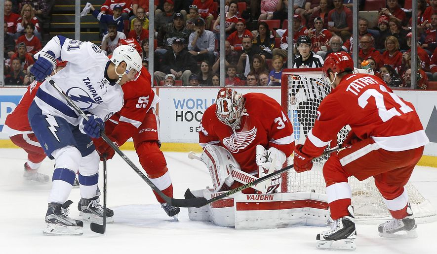 Detroit Red Wings goalie Petr Mrazek (34) stops a shot by Tampa Bay Lightning center Valtteri Filppula (51) in the first period of Game 3 in a first-round NHL hockey Stanley Cup playoff series, Sunday, April 17, 2016, in Detroit. (AP Photo/Paul Sancya)