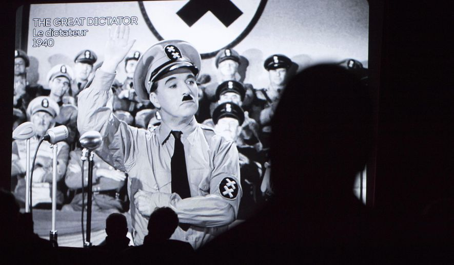 "Spectators watch  the  movie  ""The Great Dictator"" with actor Charlie Chaplin  in the cinema   during the inauguration and the opening of the museum ""Chaplin's World by Grevin"" at the Manoir de Ban, in Corsier-Sur- Vevey, Switzerland, Saturday, April 16, 2016.  Chaplin, who died in 1977, spent his last 25 years on the 14 hectares (35 acres) estate along the ""Swiss Riviera,"" at Lake Geneva.   (Laurent Gillieron/Keystone via AP)"