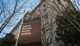 FILE - This April 13, 2014, file photo shows the Internal Revenue Service (IRS) headquarters building in Washington. Millions of taxpayers face a midnight deadline Monday, March 18, 2016, to file their tax returns, while millions of other Americans seek more time, a six-month extension. The filing deadline was delayed three days beyond the traditional April 15 deadline, because Friday was a legal holiday in the District of Columbia.  (AP Photo/J. David Ake, File)
