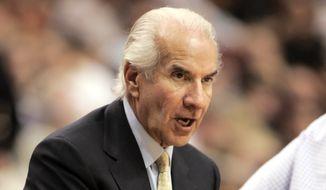 """FILE - In this March 14, 2007, file photo, Ed Snider, chairman of Comcast-Spectacor and the Philadelphia 76ers and Flyers sports franchises, watches the action from court side during the 76ers basketball game against the Chicago Bulls in Philadelphia. Ed Snider, the Philadelphia Flyers founder whose """"Broad Street Bullies"""" became the first expansion team to win the Stanley Cup, died Monday, April 11, 2016 after a two-year battle with cancer. He was 83. (AP Photo/Tom Mihalek, File)"""