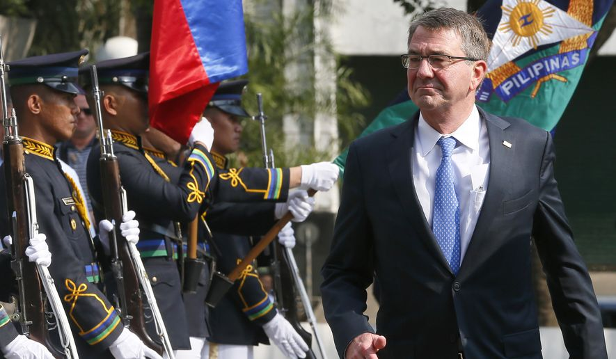 U.S. Defense Secretary Ashton Carter reviews troops as he arrives for the closing ceremony of the 11-day joint U.S.-Philippines military exercise at Camp Aguinaldo in suburban Quezon city, Philippines, in this April 15, 2016, file photo. (AP Photo/Bullit Marquez, File)
