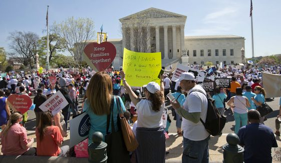 Supporters of fair immigration reform gather in front of the Supreme Court in Washington on Monday as justices hear arguments in a case that could affect millions of people living in the country illegally. (Associated Press)