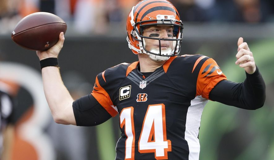 FILE - In this Dec. 13, 2015 file photo, Cincinnati Bengals quarterback Andy Dalton throws in the first half of an NFL football game against the Pittsburgh Steelers in Cincinnati. A broken thumb on his passing hand forced Andy Dalton to miss the end of another season that finished miserably. The thumb is healed and Dalton is getting ready for a sequel to his break-out season. (AP Photo/Gary Landers, File)