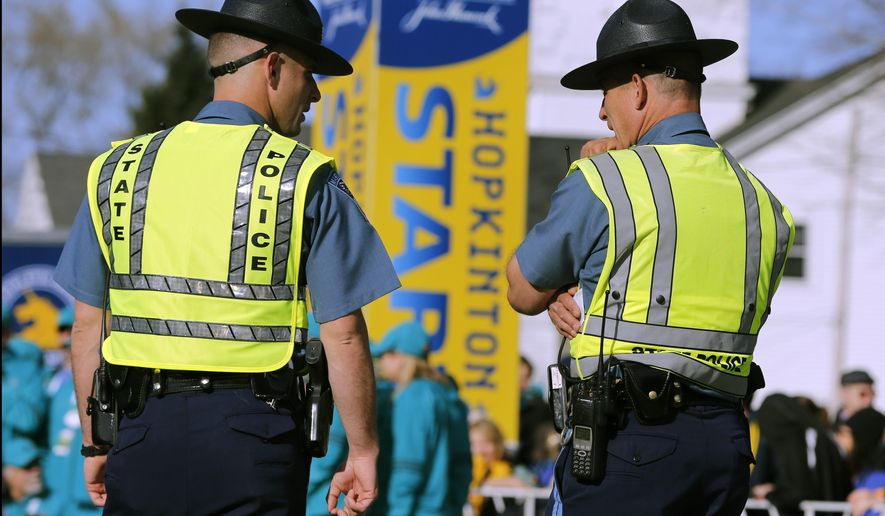 Massachusetts State Police officers stand near the starting line of the Boston Marathon on Monday, April 18, 2016, in Hopkinton, Mass. (AP Photo/Michael Dwyer)