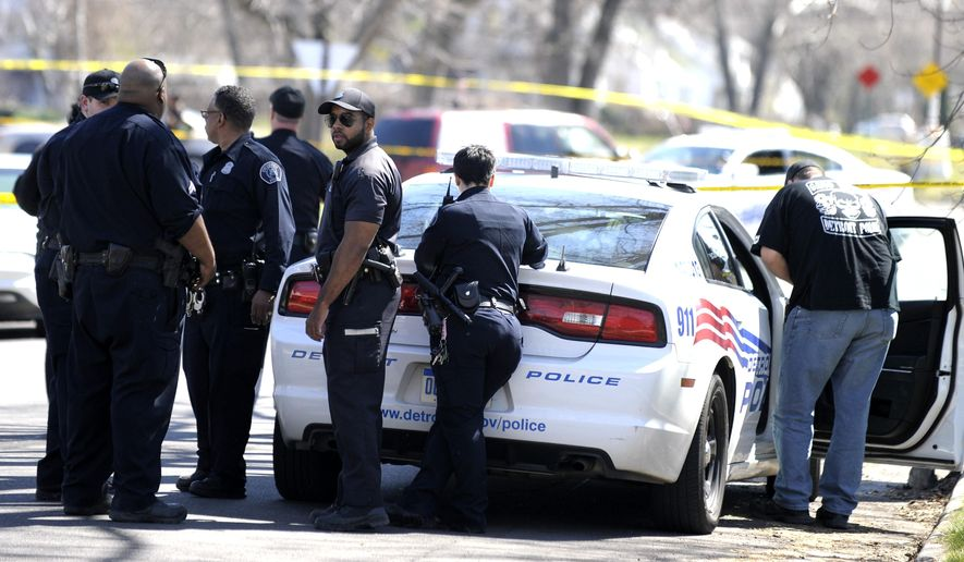 Detroit police investigate the shooting death of an infant on Winthrop between 7 Mile Rd. and Clarita, Saturday, April 16, 2016. Police say two men have been detained for questioning after a 6-month-old girl was fatally shot Saturday as she was with others in the yard outside a Detroit house. (Todd McInturf, The Detroit News via AP)